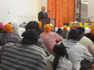 Comptroller John C. Liu speaks to Sikh devotee.