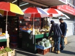 Selecting the right vegetables for a taste from home under umbrellas.