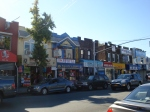 A view of some stores along Liberty Avenue and 121 street.