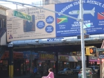 Overlooking the A train at Lefferts Boulevard lies a billboard— Travel to Guyana and Trinidad !