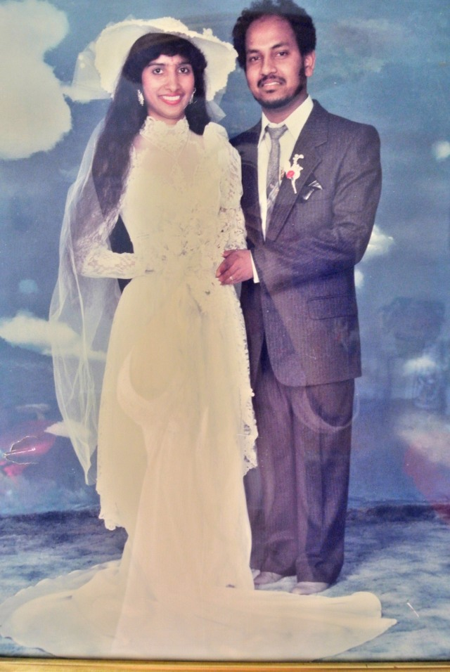 Kamelia's Parents Wedding Photo (Loving the '80s poofy sleeves on my Mom's dress and retro cloud background) Photo Credit: unnamed Bronx photo shop